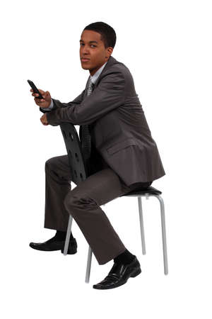 young black businessman making a call photo