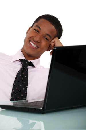casually: Businessman casually sat at desk Stock Photo