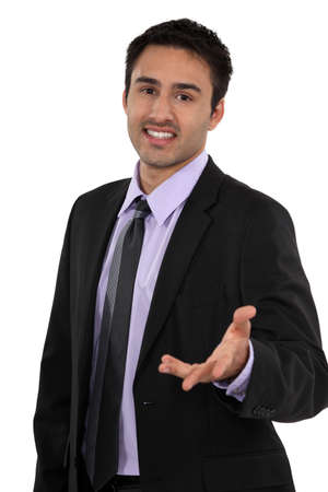 indecisiveness: Doubtful man holding his hand out Stock Photo