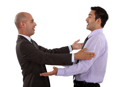 friend hug: businessmen embracing