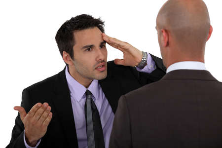 confront: Two businessmen having a difference of opinion Stock Photo
