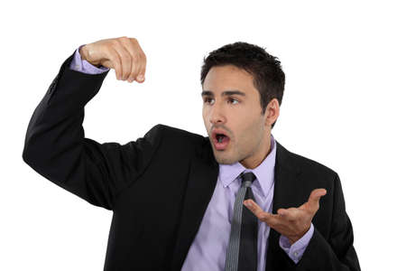 speechless: businessman shocked and speechless Stock Photo