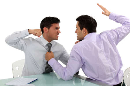 Two businessmen coming to blows photo