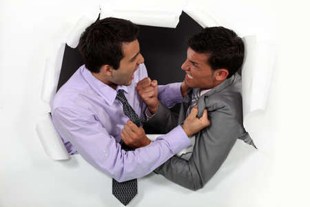 Young businessmen arguing photo