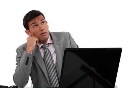 speculate: young businessman thinking about something Stock Photo