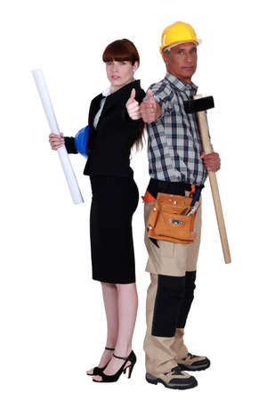 co operation: Tradesman and engineer working together