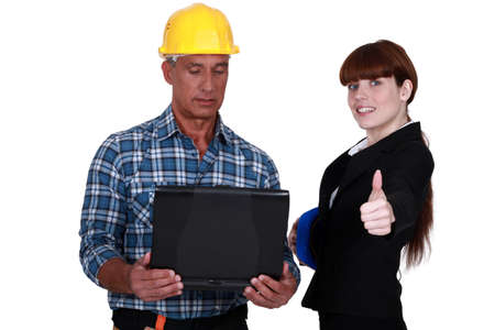 convince: Enthusiastic engineer working with an engineer Stock Photo