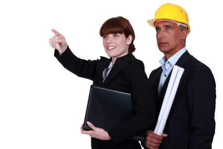 Engineer drawing the attention of her colleague Stock Photo - 15915662