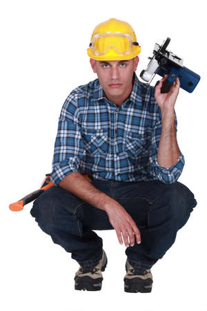 forestry industry: craftsman holding an electric saw