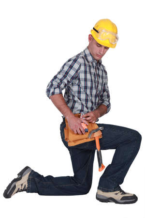 worker working: handyman kneeling