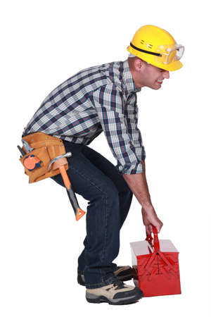Worker with a heavy tool box photo