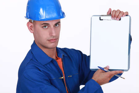 attest: Tradesman holding up a blank clipboard