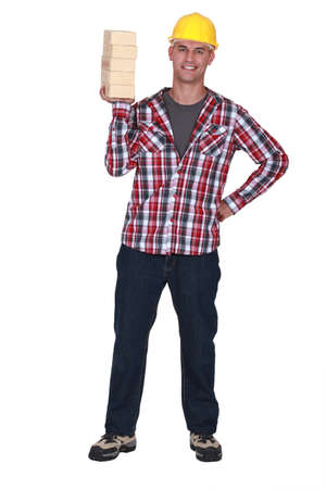cement pile: Mason holding bricks Stock Photo