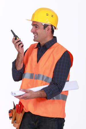 Happy architect communicating via radio Stock Photo - 15916119
