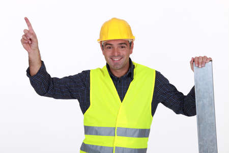 Worker in high-visibility vest pointing Stock Photo - 15916017