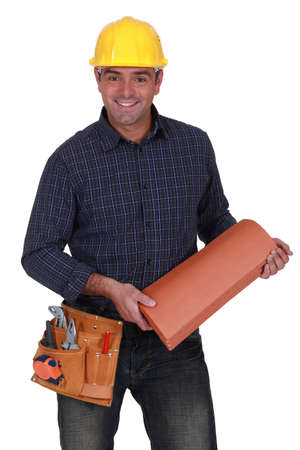 roofer: Smiling roofer standing on white background Stock Photo