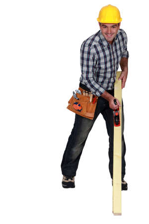 lath: Craftsman sanding wood lath Stock Photo
