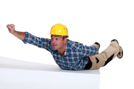 high angle shot: Manual worker in superman pose