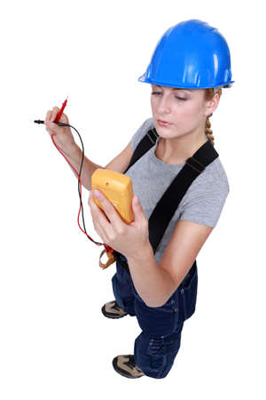capacitance: Woman taking electrical reading