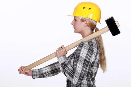 sledgehammer: Woman using sledge-hammer