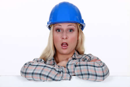 workwoman: A surprised construction worker
