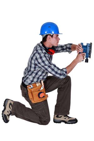 sander: Tradesman using a sander Stock Photo