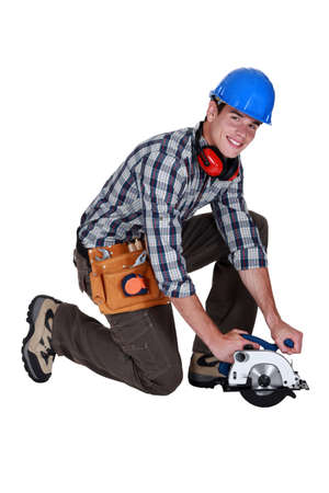 mitre: Workman with a circular saw