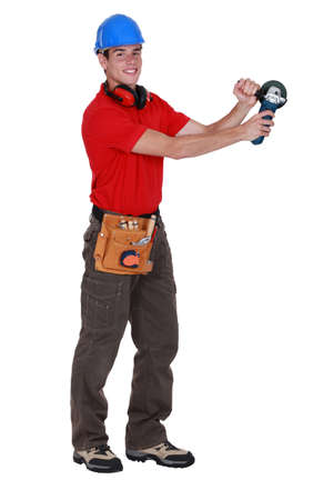 Man holding angle grinder photo