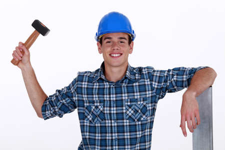 clout: Young roofer with hammer Stock Photo