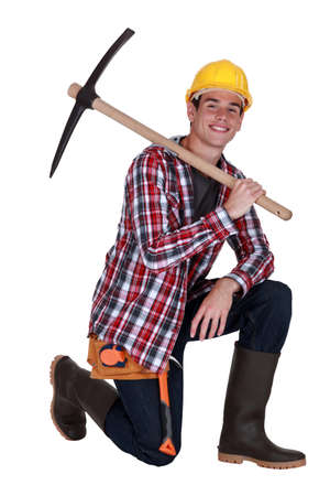 mattock: Young worker with a pickaxe