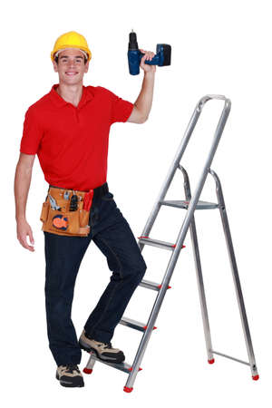 Construction worker with a drill Stock Photo - 15915630