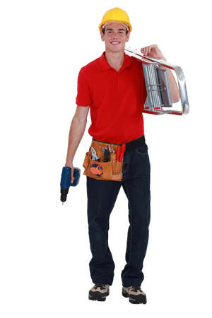 overseer: happy young carpenter carrying ladder isolated on white