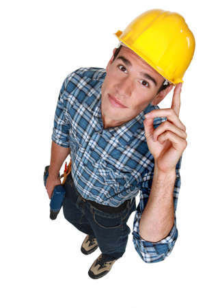 top angle view: Young construction worker with a drill