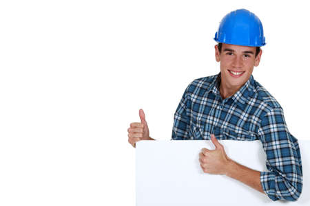 Construction worker approving a board left blank for your message photo