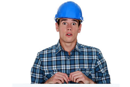 Confused young builder photo