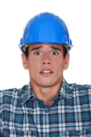 perturbed: Worried construction worker Stock Photo