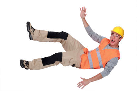 head down: Builder falling through the air Stock Photo