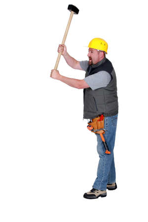 exclaiming: Tradesman holding a mallet