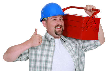 Tradesman carrying a toolbox and giving the thumb Stock Photo - 15916171
