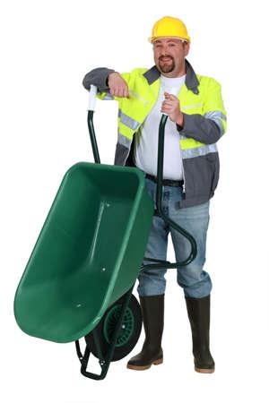 Workman with a wheelbarrow photo