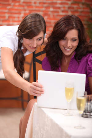 25 to 30: portrait of two businesswomen at restaurant Stock Photo