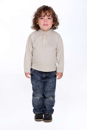 audacious: Little boy sticking tongue out Stock Photo