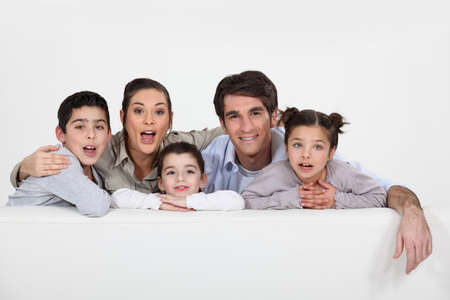Young family with a board left blank for your message Banco de Imagens - 15916024