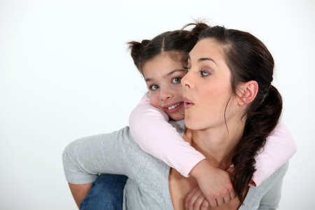 shoulder ride: Child riding piggyback Stock Photo