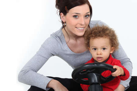 Woman and little boy on a toy car photo