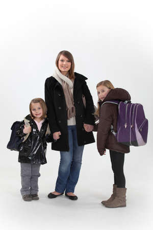 Girls with backpacks photo
