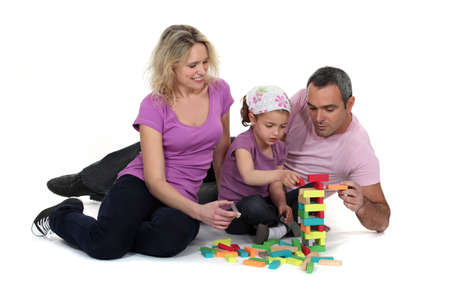 Couple and girl playing with blocks Stock Photo - 15915781