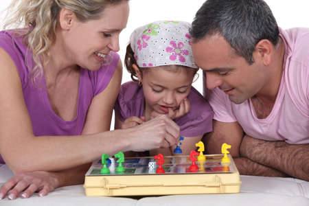 game board: Family playing a board game together