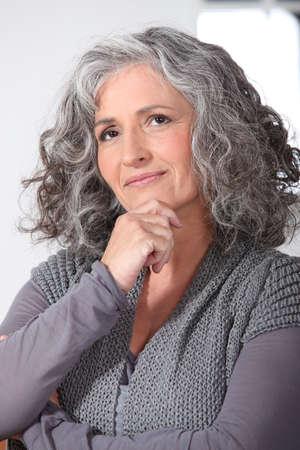 Pensativo mujer de mediana edad Foto de archivo