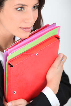 young woman dressed in suit holding file folders Stock Photo - 15915939